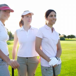 Three women on Victoria Park Golf Course in Guelph for a lesson
